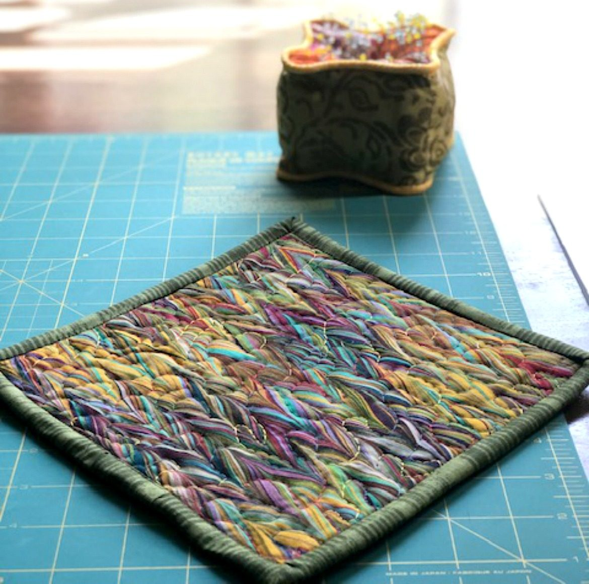 Simple Quilted Potholder Tutorial featured image of final hot pad