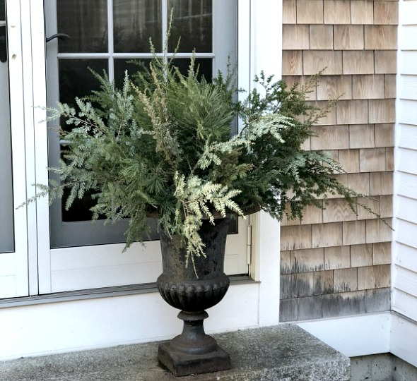 How to decorate outdoor hanger for winter Picture of green in pole iron urn