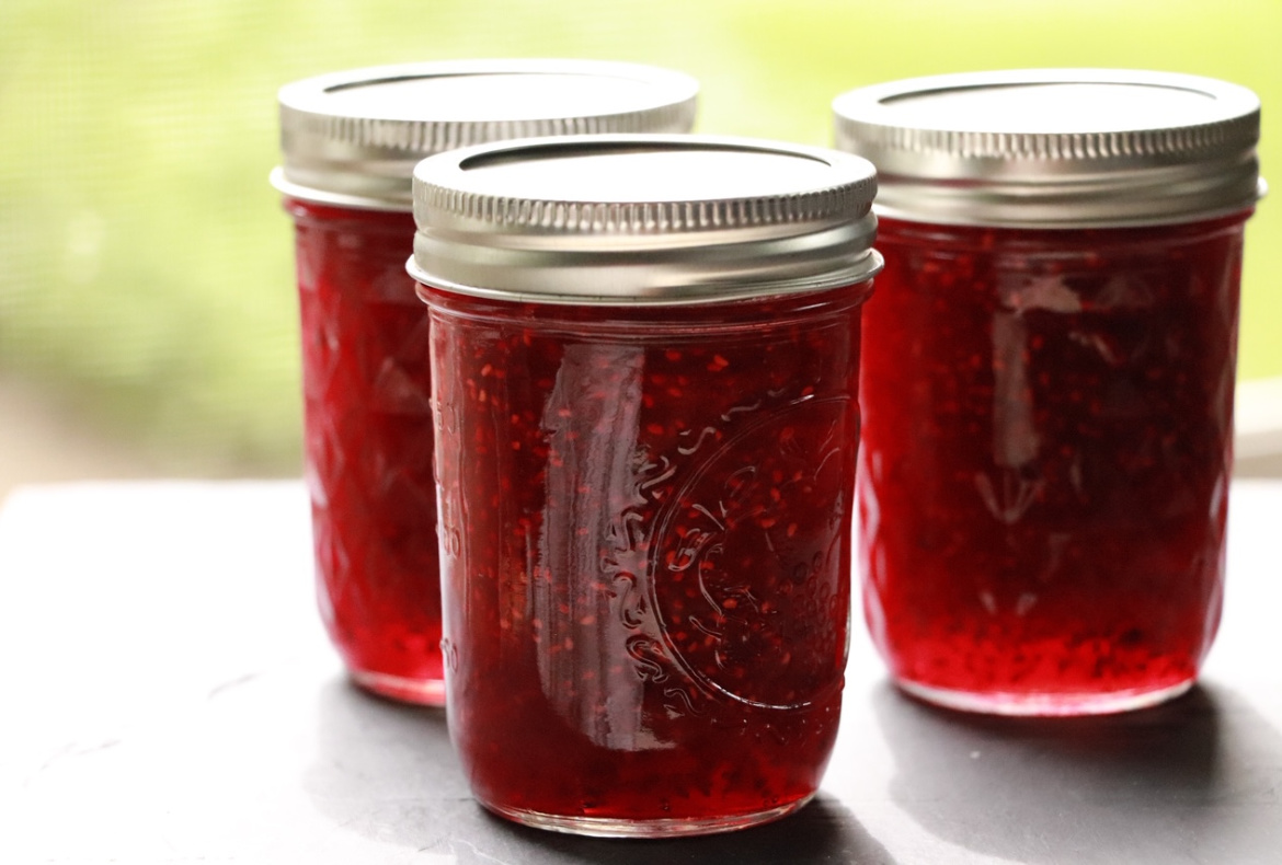 red raspberry jam in mason jars image showing 3 jars of jam